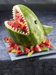 carve a watermelon into a creative shape for a table centerpiece