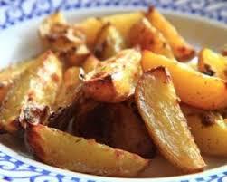 cuisiner avec la plancha recette de pommes de terre aillées à la plancha