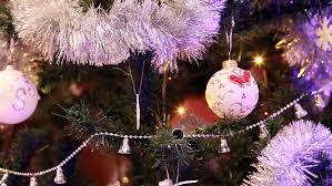 small christmas tree with balls on bar with neon lights stock