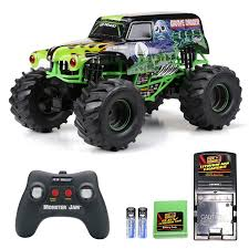monster truck toy video amazon com new bright 61030g 9 6v monster jam grave digger rc car
