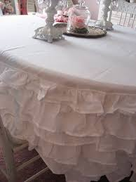 interior white fabric ruffled tablecloth for oval table added by