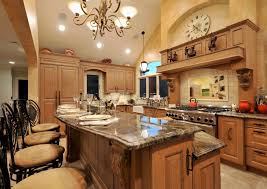 Kitchen Island Granite Countertop Chandelier Light Travertine Focal Point Tile Kitchen