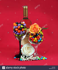 a bottle of wine two wineglasses filled with m u0026m candy and two