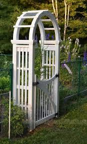 garden arch with gate gardening design