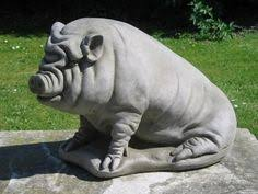 characteristic pot belly pig garden ornament carved and shaped