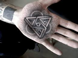dotwork masterpiece geometric tattoo on palm of hand