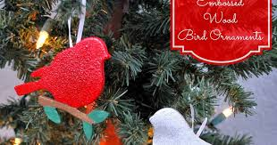 a glimpse inside embossed wood bird ornaments trim the tree