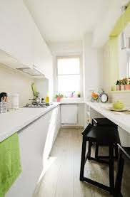 table in the kitchen bright studio apartment in romania home interior design kitchen