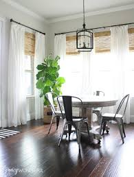 White Breakfast Nook Breakfast Nook With White Drapes Metal Chairs And A Fiddle Leaf