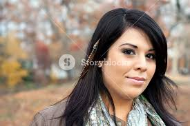 feather hair extensions beautiful hispanic woman wearing custom feather hair