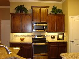furniture small kitchen design with brown kitchen cabinets and