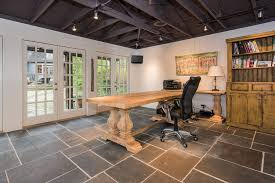 rustic home office with slate tile floors by the fred smith
