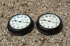 an unusual pair of bakelite wall clocks c1930 in clocks