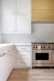 Gold Kitchen Cabinets - white kitchen cabinets with long gold pulls design ideas