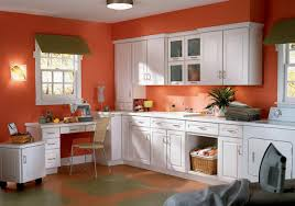 kitchen with white cabinets and orange walls aria kitchen