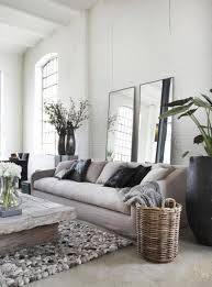 feng shui in living room with mirrors behind the sofa and black