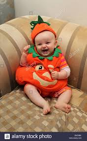 pretty halloween pictures a pretty little baby dressed as a pumpkin at halloween in