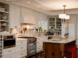 photo page hgtv traditional kitchen with white cabinets and wood island