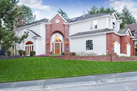 Three Car Garage Luxury House Exterior With Red Brick Wall Trim With Three Car