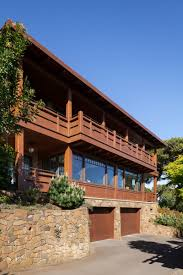 the profound delight in personal expression arts crafts homes a stone foundation supports two upper levels constructed of western red cedar