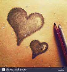 a simple pencil drawing of two hearts stock photo royalty free