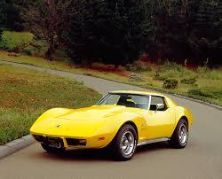 1976 corvette yellow 1976 chevrolet corvette stingray yellow 3 4 front view on pavement