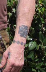 why does mickey rourke have swastika and iron cross tattoos