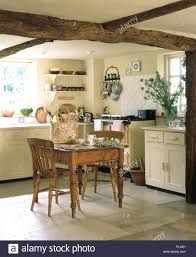 Rustic Vintage Dining Area Vintage Pine Dining Table And Chairs In A Cream Cottage Kitchen