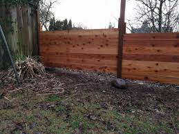fill gap on slope with horizontal fence home improvement stack