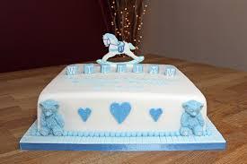 baby boy christening cake with handmade fondant rocking horse