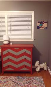 exciting side table dresser with bold red color paint and chevron