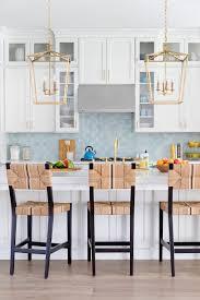 blue kitchen backsplash white cabinets kitchen blue backsplash white cabinetry gold brass lanterns