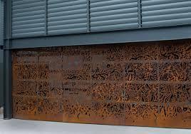 Garage Door Designs by Axolotl Metal Garage Door Rust Router Cut Design Susan