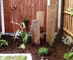 native plant landscaping ideas three upright railway sleepers draw the eye to the corner of the