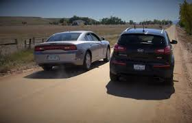 a different drag race kia sportage t gdi vs dodge charger r t