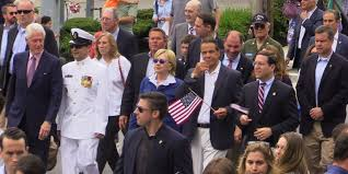 hillary and bill clinton andrew cuomo march in chappaqua parade