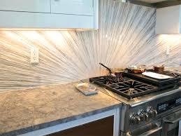 beach glass tile backsplash granite light wood floors with dark