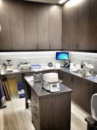 stained custom cabinetry for the sterilization unit dental