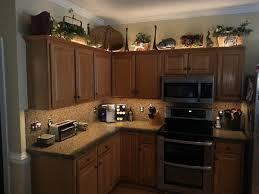What To Put Above Kitchen Cabinets by Decorativeative Over Kitchen Cabinets Roselawnlutheran