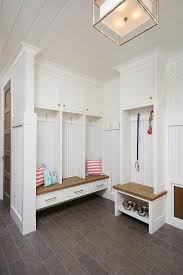 cottage mudroom features a shiplap ceiling over mudroom lockers