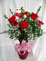 a dozen roses vase of a dozen roses serenity flowers gifts