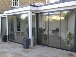 Accordion Glass Patio Doors Cost Wonderful Frameless Folding Doors Photos Ideas House Design