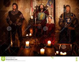 medieval king with his queen and knights on guard in castle