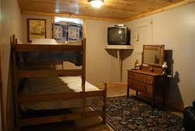 Bedroom Bed In Corner Traditional Basement Bedroom Ideas With Classy Wood Bunk Bed Feat