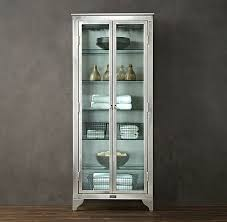 tall cabinet with glass doors glass cabinets for a chic display