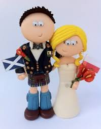 19 best personalised wedding cake toppers to show jobs and hobbies