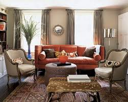 Living Room With Orange Sofa Not So Sure About The Deer Pelt Antler Ottoman Orange Sofa