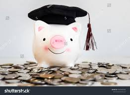 graduation piggy bank piggy bank wearing graduation cap coinssave stock photo 1007982658