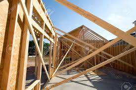 a new home being built with wood trusses supports and a