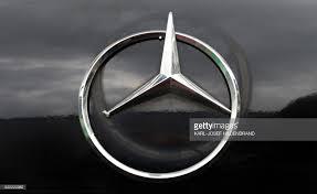mercedes maker a damaged logo of german car brand mercedes by car maker